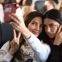 Adriana Lima and Lily Aldridge aboard the flight