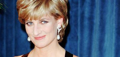ad543b30cc DECEMBER 1995 - Still wearing her famous engagement ring with co-ordinating  sapphire and diamond cuffs