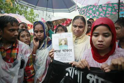 Bangladeshi activists and relatives of victims of the Rana Plaza building collapse take part in a protest march on the fourth anniversary of the disaster at the collapse site at Savar, near Dhaka, Bangladesh