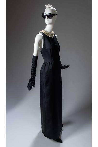 The Givenchy evening sheath dress worn by Holly Golightly, as played by Audrey Hepburn, in the opening scene of the Blake Edwards film, [i]Breakfast at Tiffany's[/i], 1961. Following its debut in the film, the black sheath has become an eternal element of the style lexicon