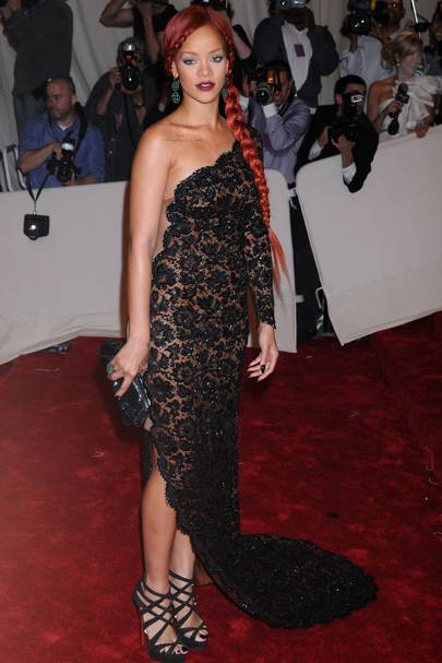 "MAY 2011 - Rihanna in an asymmetric, black lace embroidered gown from Stella McCartney.   <A target=""_blank"" href=""http://www.vogue.co.uk/search/default.aspx/Shows/?designer=Alexander+McQueen"">[b] SEE THE MCQUEEN SHOW ARCHIVE[/b]</a>"