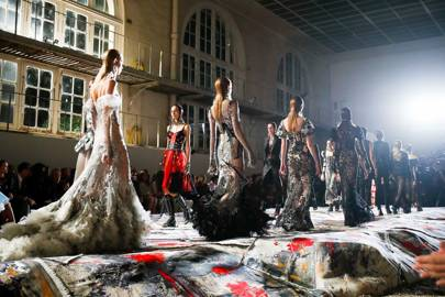 """The McQueen catwalk was covered with Scottish """"Taatit"""" rugs, which are traditionally made by the bride and groom's families together and then presented as a gift to the newlyweds"""