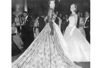 The French actress Capucine (the future star of [i]The Pink Panther[/i] and [i]What's New, Pussycat?[/i]), wearing Givenchy at the Versailles ball in 1952