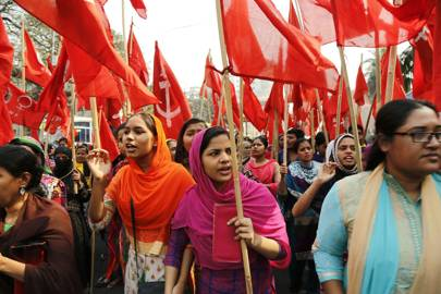 Garment workers attend a protest rally organised by the National Garment Workers Federation (NGFW) demanding the release of 25 of their leaders, a raise in their salaries and the reopening of closed factories in Dhaka, Bangladesh, in February 2017.