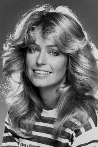 """JANUARY 1977 - As Jill Munroe in Charlie's Angels Fawcett's hair inspired thousands of women to """"flick"""" theirs. Her hairstyle was the """"Rachel"""" of its time."""