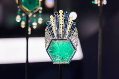 Carved emerald brooch with diamonds and sapphires, designed by Paul Iribe and made by Robert Linzeler, Paris, 1910   Credit: Bejewelled Treasures, The Al Thani Collection, Servette Overseas Limited 2014 Victoria and Albert Museum. Photograph Prudence Cuming Associates Ltd