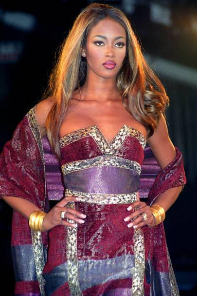 OCTOBER 1991 – For the British Fashion Awards in 1991, Naomi Campbell was flown in with Linda Evangelista and Claudia Schiffer for a truly star-studded event that also saw Boy George perform with his band, Jesus Loves You.