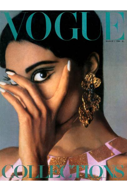Eye in the International Collections - this issue, news from Paris, Italy, London, Spain and New York. Make-up by Lancôme. dress, Chloe. Earrings, Mimi di N., 7gns., at Dickens & Jones. Photograph by David Bailey   Donyale Luna becomes the first cover model of ethnic origin for [i]Vogue[/i], for an issue entitled [i]Eye on the International Collections[/i]. The big fashion statements in the shoots sum up the style mood of the day: huge eyelashes, candy coloured tunic dresses (Jean Patou), long chiffon dresses by Cardin, plastic diamond dresses by Pierre Cardin and thick crochet tights.