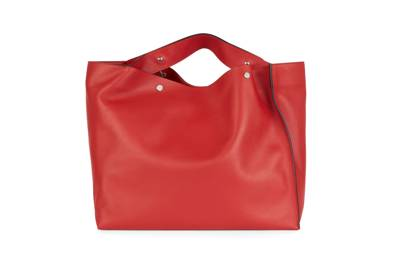 A large, squashy shopper – such as this one by Marni, in pillar-box red leather with brass hardware – is luxury and practicality rolled into one